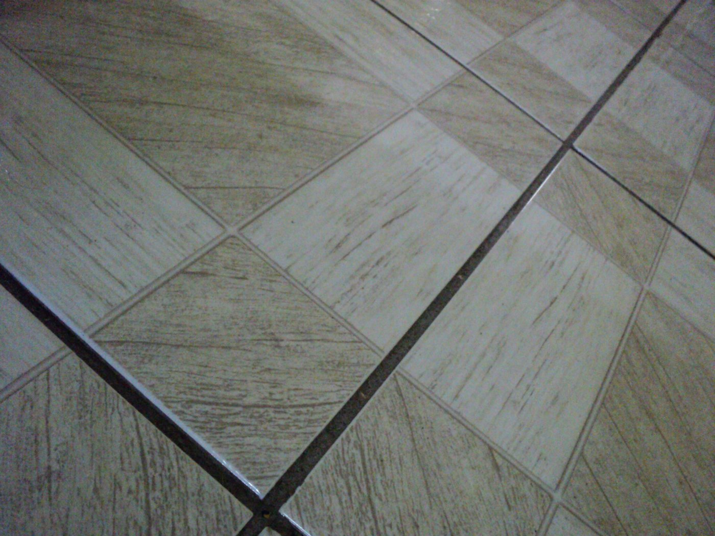 How to tile a floor floor tiling tiles groutg dailygadgetfo Gallery