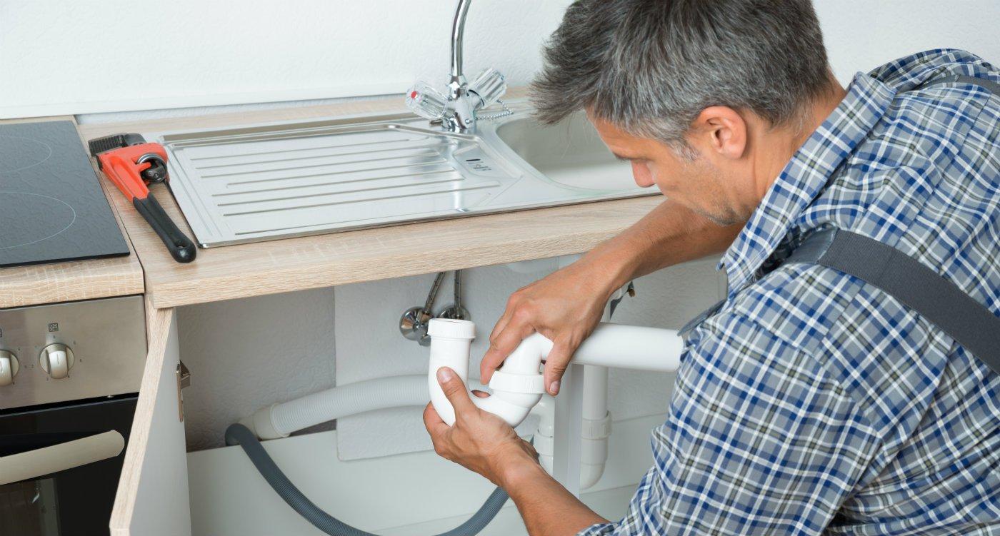 Landlord managing tradesmen plumber electrician.jpg