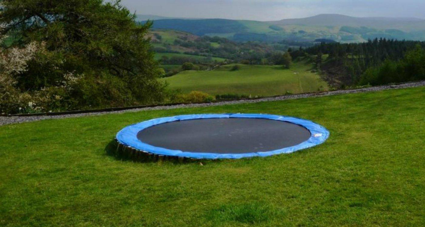 Sunken trampoline installation garden final.jpg